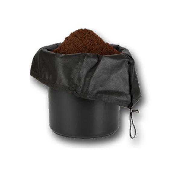 black pot with black mesh bag inside with soil