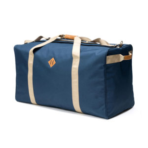 Abscent The Transporter in blue canvas and cream accents.